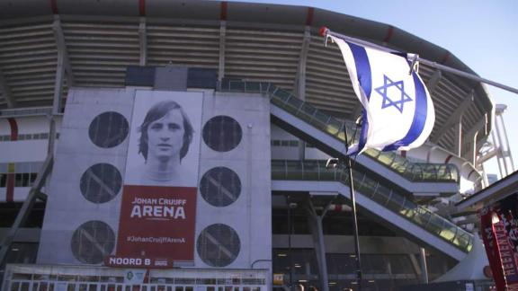 An Israeli flag can be seen flying outside the Ajax stadium in Amsterdam.