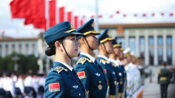 BEIJING, CHINA - SEPTEMBER 30: Members of a military honour guard  before a ceremony at Tiananmen Square, on the eve of National Day on September 30, 2018 in Beijing, China. On October 1, 1949, Chinese leader Mao Zedong stood at the Tiananmen Rostrum to declare the founding of the People