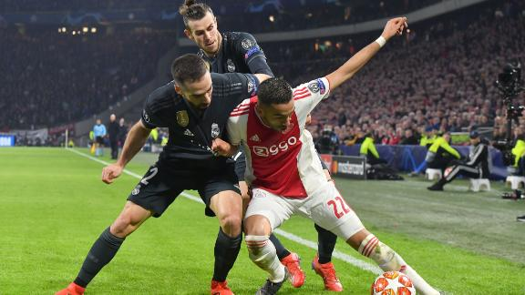 Ajax midfielder Hakim Ziyech (R) fights for the ball with Real Madrid