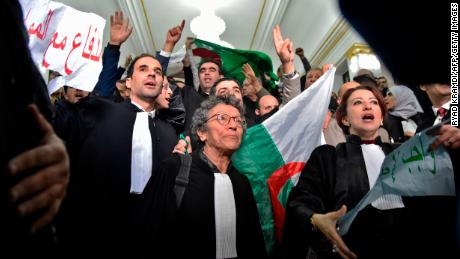 "Algerian lawyers protest on February 25, holding up placards with slogans in Arabic that read: ""The lawyers are with the people."""