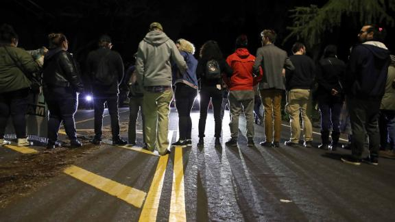 Protesters block an intersection to demonstrate the decision by Sacramento District Attorney not to charge the Sacramento police officers who shot and killed Stephon Clark last year.