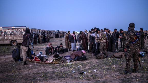 Suspected ISIS fighters who fled Baghouz await processing.