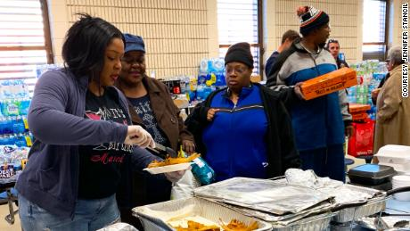 Makitha Griffin, left, has been feeding first responders and survivors after tornadoes swept through southeastern Alabama over the weekend.