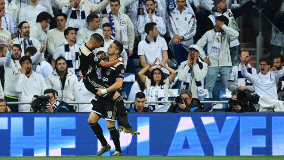 Hakim Ziyech celebrates Ajax's first goal with Dusan Tadic in front of the Real Madrid fans.