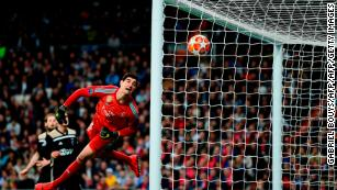Real Madrid's Belgian goalkeeper Thibaut Courtois concedes a fourth goal during the UEFA Champions League round of 16 second leg football match between Real Madrid CF and Ajax at the Santiago Bernabeu stadium in Madrid on March 5, 2019.