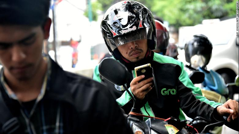 A GrabBike rider in Jakarta. Grab plans to use a lot of the recent money it has raised to beef up its business in Indonesia. Image: CNN Business