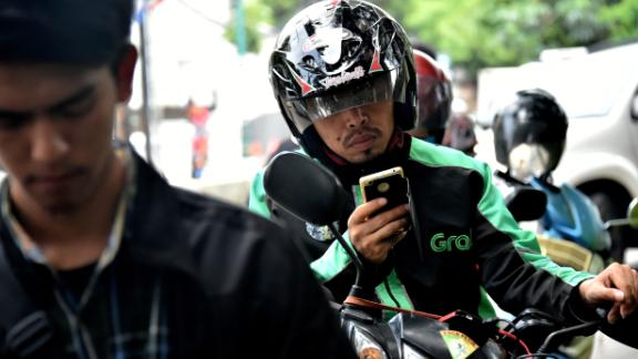 A GrabBike rider in Jakarta. Grab plans to use a lot of the recent money it has raised to beef up its business in Indonesia.