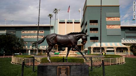 A statue of Zenyatta stands in the paddock gardens area at Santa Anita Park Tuesday.