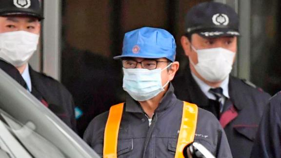 Former Nissan Motor Co. Chairman Carlos Ghosn (wearing blue hat) is released on March 6, 2019, from the Tokyo Detention House, where he was held for 108 days over financial misconduct allegations. (Kyodo via AP Images) ==Kyodo