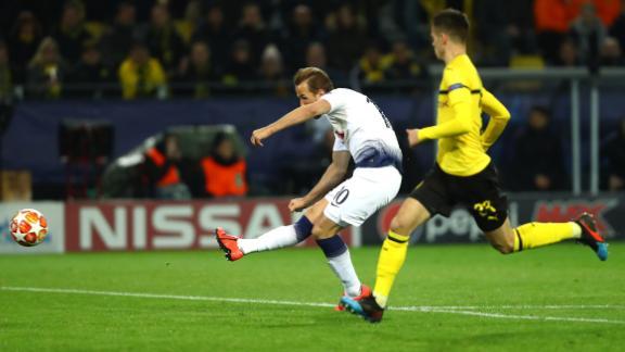 Harry Kane fires home his side's winning goal in Dortmund.