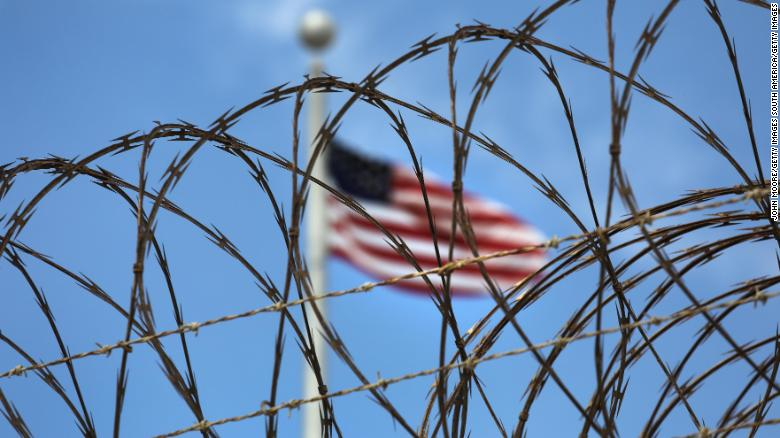 Razor wire tops the fence of the US prison at Guantanamo Bay on October 23, 2016 at the U.S. Naval Station at Guantanamo Bay, Cuba.