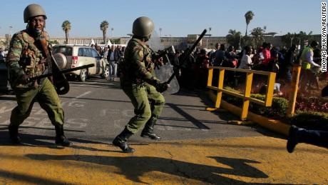 Riot police officers disperse striking aviation workers at the Jomo Kenyatta International Airport in Nairobi, Kenya.