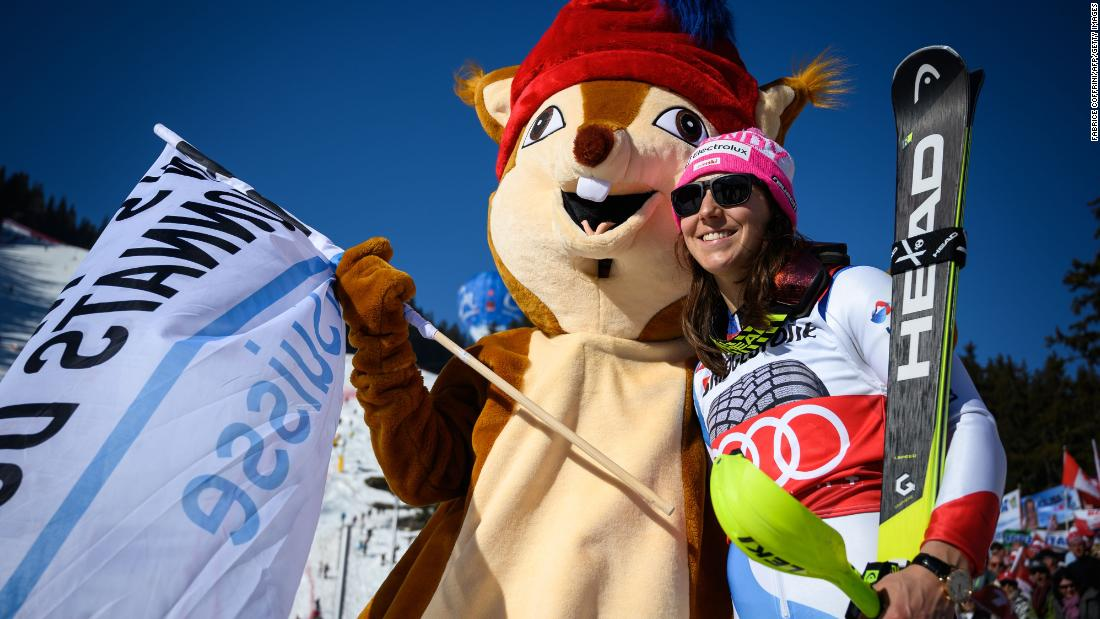 Switzerland's Wendy Holdener poses with a furry mascot during the combined event at Crans-Montana.