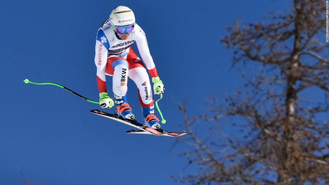 Switzerland's Priska Nufer leaps as she competes in the downhill at Crans-Montana.