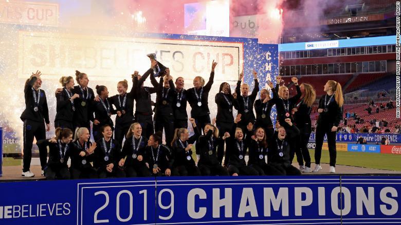 England celebrates winning the SheBelieves Cup at Raymond James Stadium.