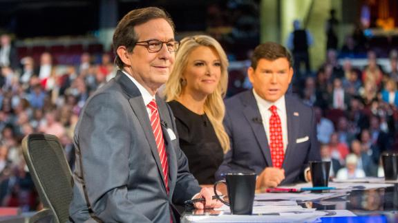 Fox News moderators Chris Wallace, Megyn Kelly and Bret Baier appear for the first Republican presidential debate in Cleveland on Dec. 21, 2015