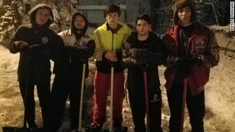 Patrick Lanigan and his friends shovel neighbor's driveway during winter storm