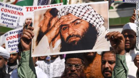 Indian Muslims hold a scratched photo of Jaish-e-Mohammad group chief, Masood Azhar, who was added to a UN sanctions list on Wednesday.