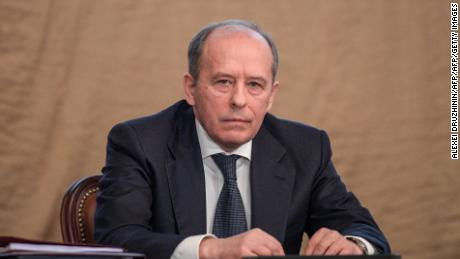 Alexander Bortnikov, director of the FSB, sat alongside Vladimir Putin as he delivered his speech.