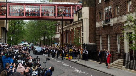 Crowds greet Prince William and the Duchess of Cambridge at the Lindo Wing of St. Mary