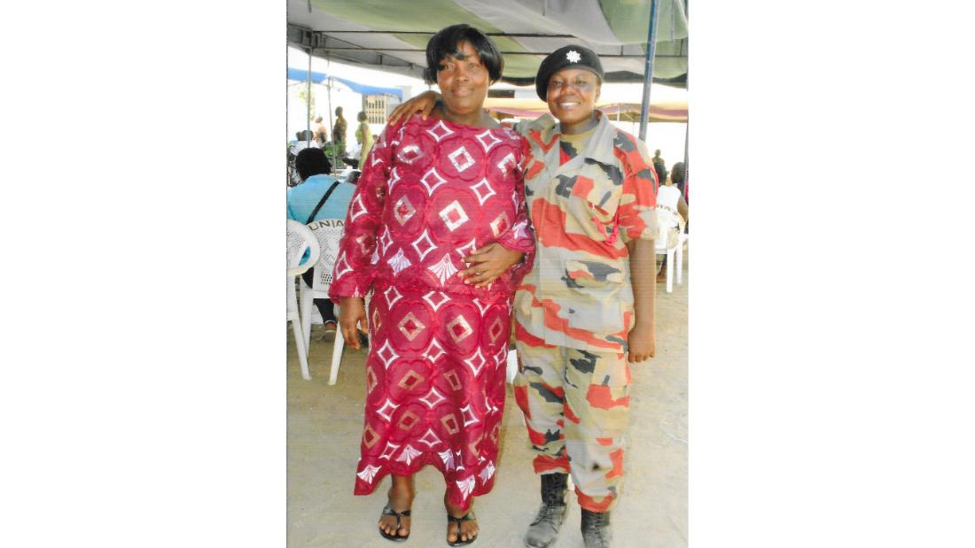 Thelma (right), with her mother, at her graduation from fire service training school.