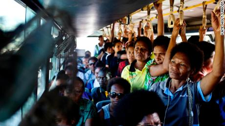 Women ride on a woman-only bus to work that is supported by UN Women as part of a program to reduce violence against women in Port Moresby, Papua New Guinea, on February 26, 2019.