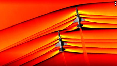 NASA captured the first ever air-to-air images of shock waves interacting from two supersonic T-38 US Air Force jets.