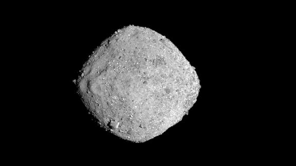 This Nov. 16, 2018, image provide by NASA shows the asteroid Bennu. After a two-year chase, a NASA spacecraft has arrived at the ancient asteroid Bennu, its first visitor in billions of years. The robotic explorer Osiris-Rex pulled within 12 miles (19 kilometers) of the diamond-shaped space rock Monday, Dec. 3. The image, which was taken by the PolyCam camera, shows Bennu at 300 pixels and has been stretched to increase contrast between highlights and shadows. (NASA/Goddard/University of Arizona via AP)