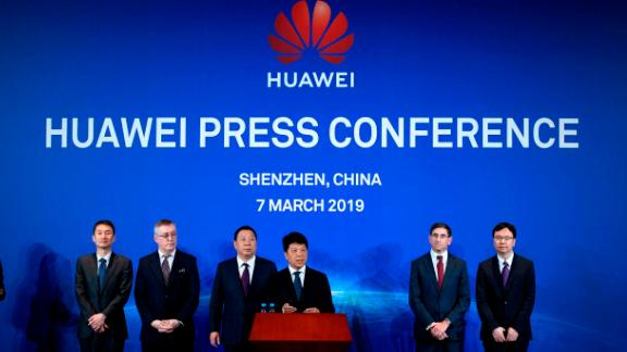 Huawei Deputy Chairman Guo Ping, center, announcing a lawsuit against the US government on Thursday.