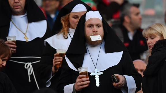 "It wouldn't be Six Nations rugby without a ""nun"" at the Stadio Olimpico. There are almost too many elements here to analyze. The rope, the cross, the man -- ticket semi-digested, beer clutched -- his startled face etched with a confused angst. Did he forget to lock the front door?"
