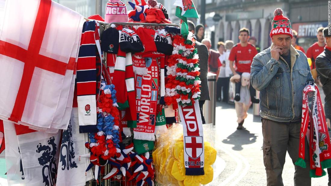 An image of so many layers. If you can look past the daffodil head frames and the half-and-half scarves, there's actually a man coming up behind on the shoulders of a toy child. What a tournament.