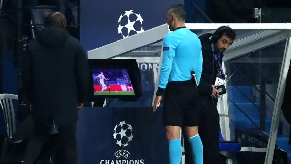 Match referee Damir Skomina checks the VAR system before awarding a penalty in favor of Manchester United.