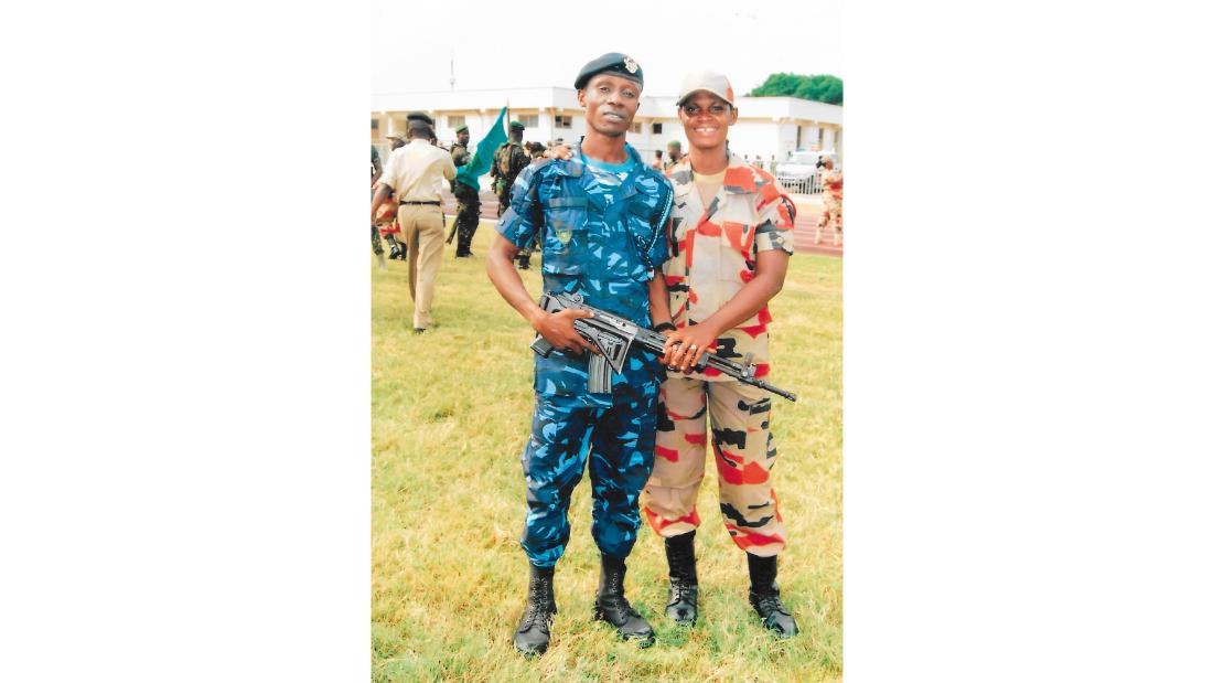Grace and her husband Seidu Abubakari in their  uniforms.