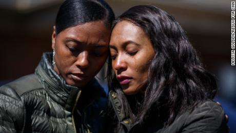 Krystal Stenson-Garrett, left, mourns with her cousin Montasha Preston outside the Peterson and Williams Funeral Home in Opelika, AL on Wednesday, March 6, 2019.