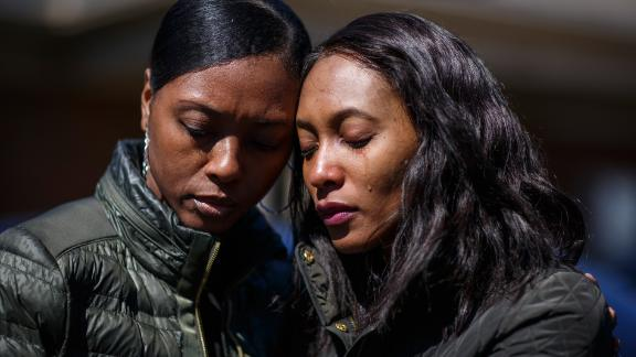 Krystal Stenson-Garrett, left, mourns with her cousin Montasha Preston outside the Peterson and Williams Funeral Home in Opelika, AL on Wednesday, March 6, 2019. Preston was a survivor of the tornadoes that hit Lee County and killed four members of her and Krystal's family.