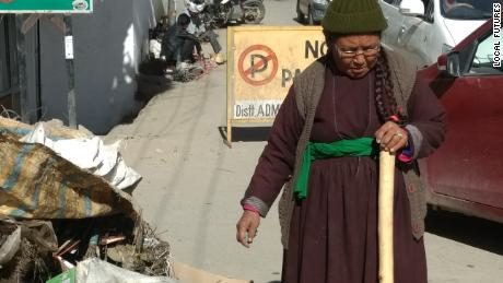 The president of the Women's Alliance of Ladakh examines a pile of plastic waste collected in Leh, northern India.