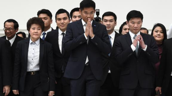 Thai Raksa Chart party leader Preechaphol Pongpanich with other officials before the Constitutional Court ruled to dissolve the party in Bangkok on March 7, 201.