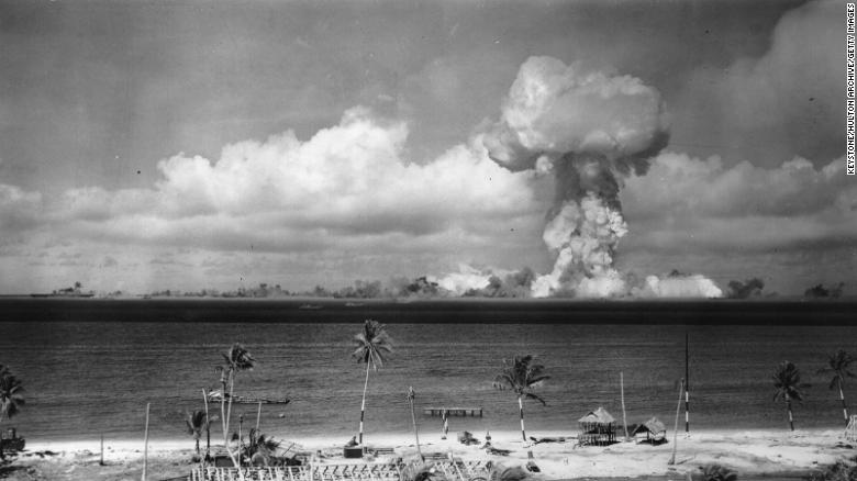 A mushroom cloud forms after the initial atomic bomb test explosion off the coast of Bikini Atoll, Marshall Islands in July 1946.