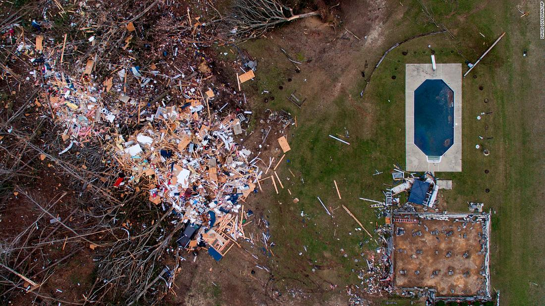 "Debris litters a yard in Beauregard, Alabama, on Monday, March 4. <a href=""https://www.cnn.com/2019/03/04/weather/gallery/southeast-tornadoes/index.html"" target=""_blank"">Powerful tornadoes</a> plowed through Alabama's Lee County the day before, killing at least 23 people and leaving homes in ruins."