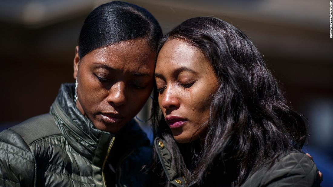 "Krystal Stenson-Garrett, left, mourns with her cousin Montasha Preston outside a funeral home in Opelika, Alabama, on Wednesday, March 6. They lost four family members to <a href=""https://www.cnn.com/2019/03/04/weather/gallery/southeast-tornadoes/index.html"" target=""_blank"">the tornadoes</a> that hit Alabama's Lee County on Sunday."