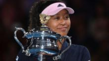 Osaka holds the Daphne Akhurst Memorial Cup following victory over Petra Kvitova in the Australian Open final.