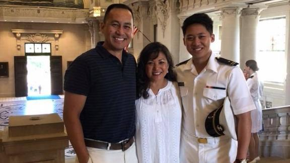 """Nick Paraiso, co-host of the """"Thank You For Your Service"""" podcast, with his parents at the US Naval Academy."""