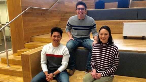 """Nick Paraiso and Thomas Krasnican, co-hosts of the """"Thank You For Your Service"""" podcast, with Sarah Claudy, who acts as creative consultant for show, in the lobby of the University of Chicago Harris School of Public Policy."""