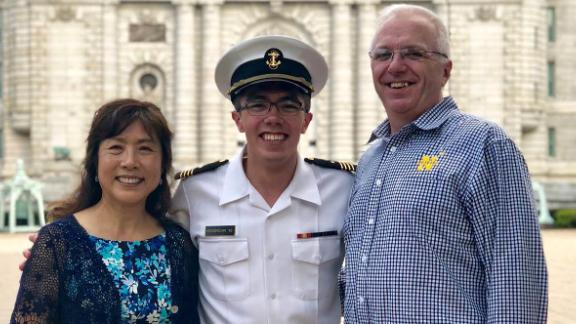 """Thomas Krasnican, co-host of the """"Thank You For Your Service"""" podcast, with his parents at the US Naval Academy."""