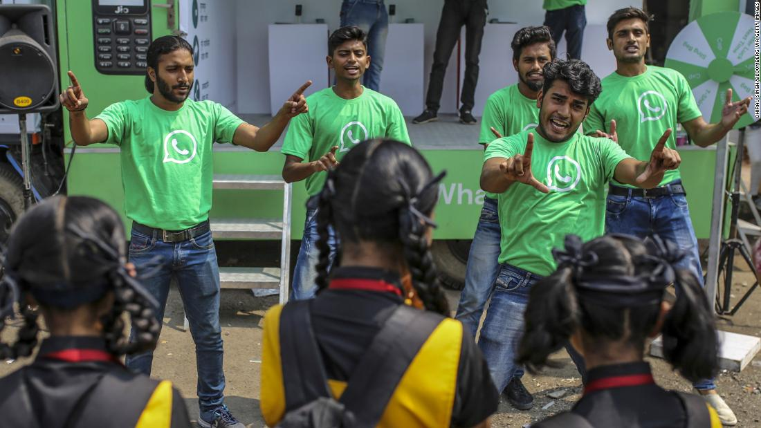 WhatsApp ambassadors perform a skit during a roadshow for the messaging service in Pune, India in October. Cheap phones and rock-bottom rates mean more Indians are using the app.