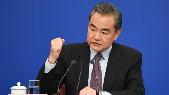 "China's Foreign Minister Wang Yi reacts as he answers a question during a National People's Congress press conference in Beijing on March 8, 2019. - China threw its weight behind Huawei's legal battle against the United States on March 8, vowing to take all necessary measures to defend the ""legitimate rights"" of Chinese companies and individuals. (Photo by WANG ZHAO / AFP)        (Photo credit should read WANG ZHAO/AFP/Getty Images)"