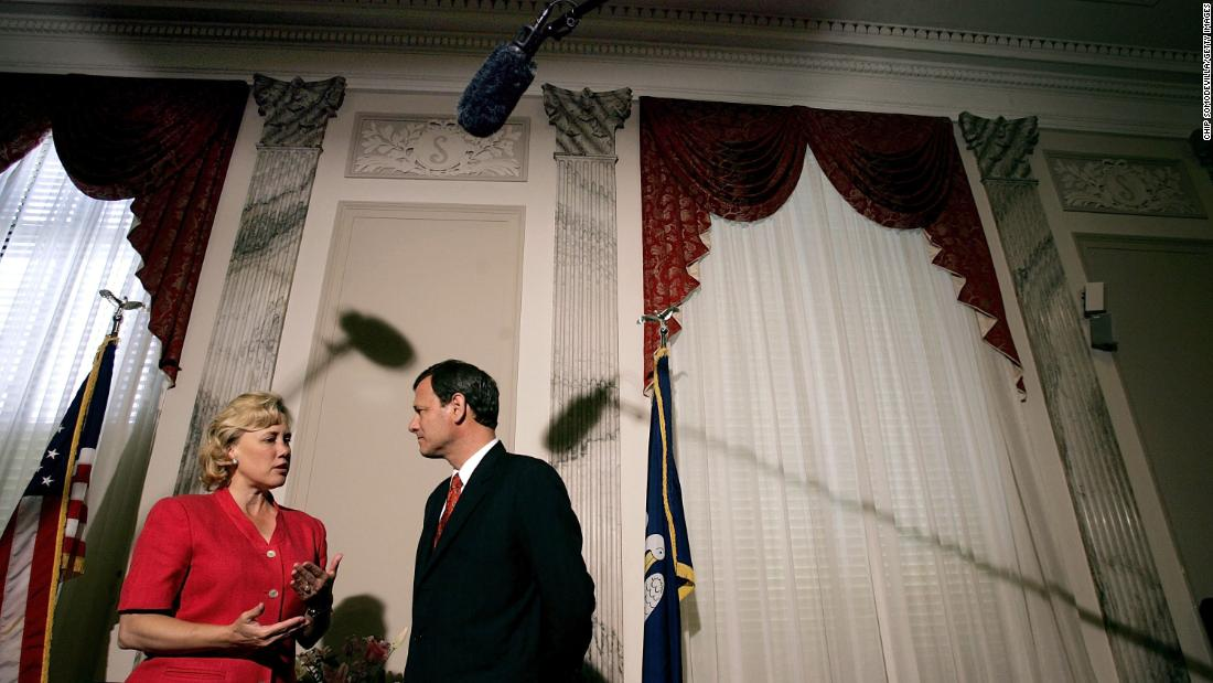 Roberts meets with US Sen. Mary Landrieu as he makes his rounds on Capitol Hill in July 2005.