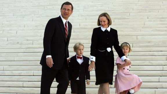 The Roberts walk with their children, Jake and Josie, after he took the Supreme Court bench for the first time in October 2005.