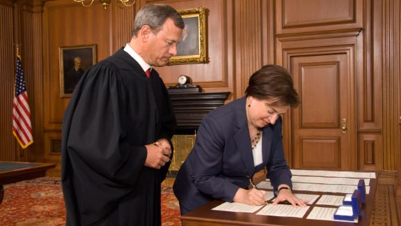 Roberts watches Elena Kagan sign the Oaths of Office after she replaced retiring Justice John Paul Stevens in 2010.