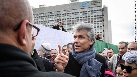 Algerian businessman and political activist Rachid Nekkaz (C) at a protest in front of the Geneva University Hospitals buildings in Geneva, Switzerland, on Friday.